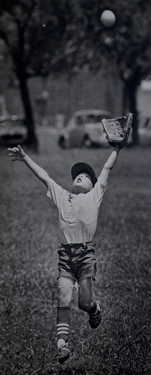 SHREVEPORT: A pee-wee leaguer prepares to make a catch during a game in 1975.