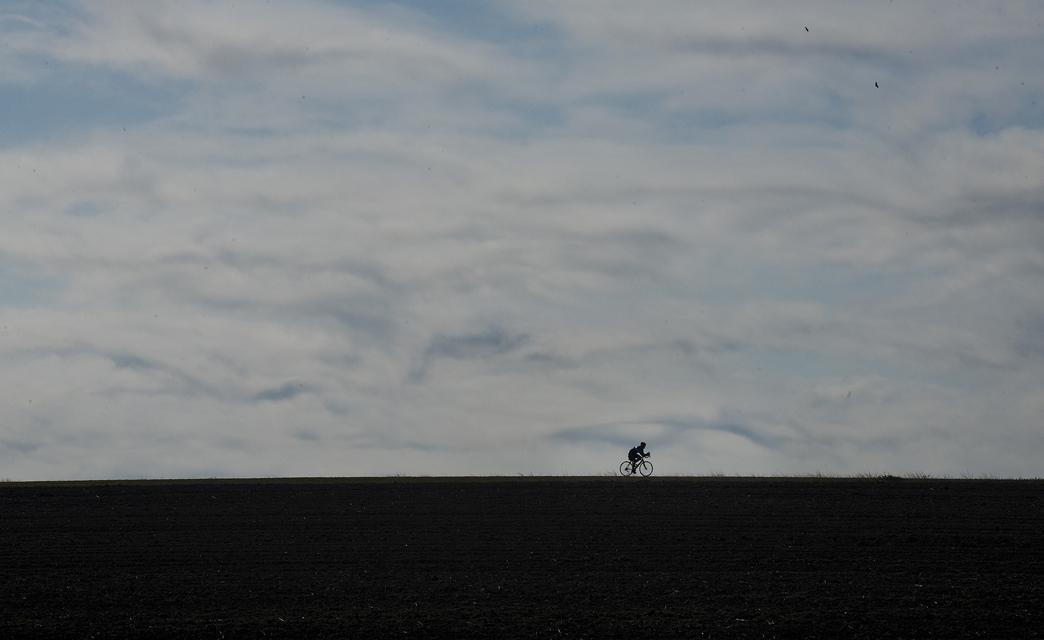A lone cyclist outside Bartlett, Texas.