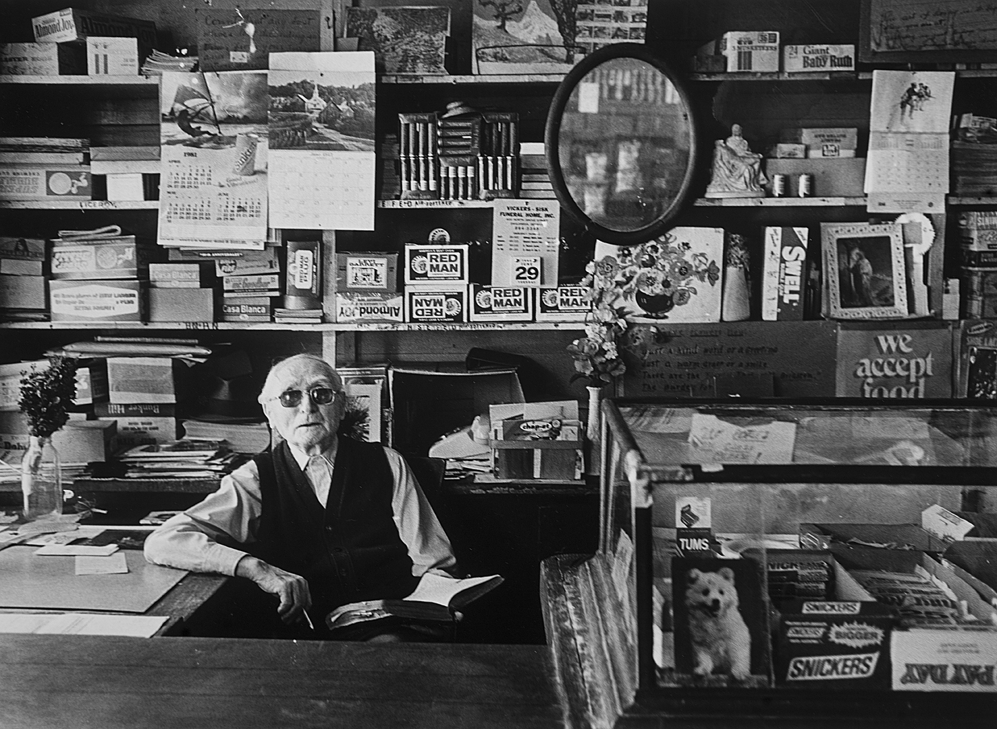 Dahlonega, GA -- Mr. Nelson Anderson Nix, age 97 when this photo was taken in 1981, sits at the helm of his store, Nix Grocery, on the Dahlonega square.