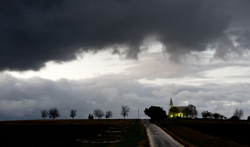 Clouds begin to lift over Prince of Peace Lutheran Church in Wuthrich Hill, Texas.