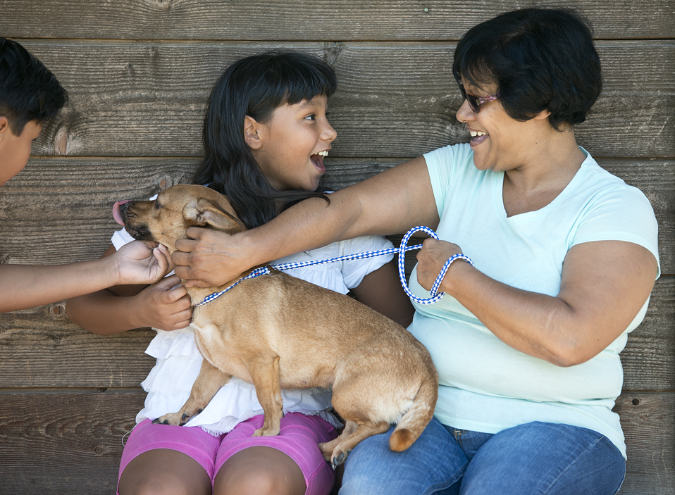 Elizabeth George with grankids Julianna Santiago and her brother, Joelle. And new family member, Sadie.